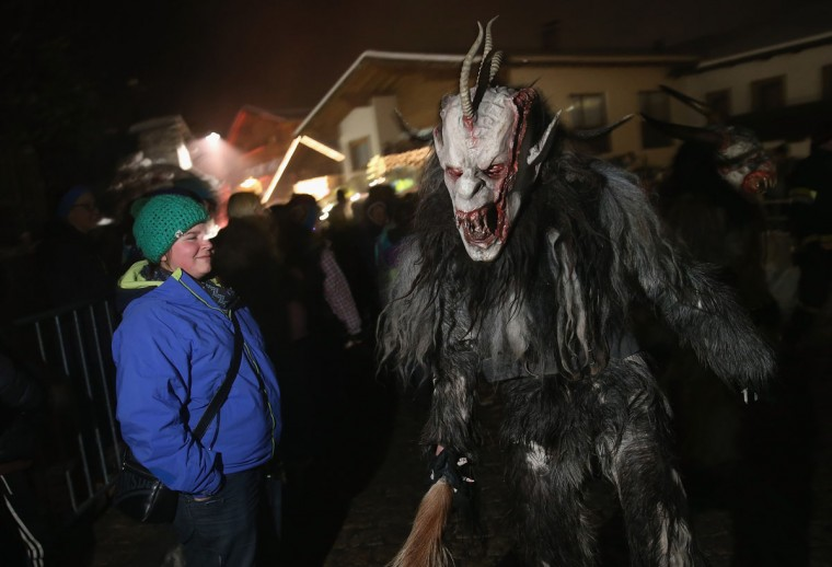 A participant dressed as the Krampus creature confronts onlookers during his search for delinquent children during Krampus night on November 30, 2013 in Neustift im Stubaital, Austria. Sixteen Krampus groups including over 200 Krampuses participated in the first annual Neustift event. Krampus, in Tyrol also called Tuifl, is a demon-like creature represented by a fearsome, hand-carved wooden mask with animal horns, a suit made from sheep or goat skin and large cow bells attached to the waist that the wearer rings by running or shaking his hips up and down. Krampus has been a part of Central European, alpine folklore going back at least a millennium, and since the 17th-century Krampus traditionally accompanies St. Nicholas and angels on the evening of December 5 to visit households to reward children that have been good while reprimanding those who have not. However, in the last few decades Tyrol in particular has seen the founding of numerous village Krampus associations with up to 100 members each and who parade without St. Nicholas at Krampus events throughout November and early December. (Sean Gallup/Getty Images)