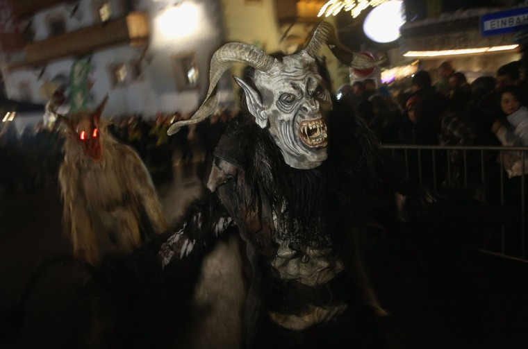 Participants dressed as the Krampus creature walk the streets in search of delinquent children during Krampus night on November 30, 2013 in Neustift im Stubaital, Austria. Sixteen Krampus groups including over 200 Krampuses participated in the first annual Neustift event. Krampus, in Tyrol also called Tuifl, is a demon-like creature represented by a fearsome, hand-carved wooden mask with animal horns, a suit made from sheep or goat skin and large cow bells attached to the waist that the wearer rings by running or shaking his hips up and down. Krampus has been a part of Central European, alpine folklore going back at least a millennium, and since the 17th-century Krampus traditionally accompanies St. Nicholas and angels on the evening of December 5 to visit households to reward children that have been good while reprimanding those who have not. However, in the last few decades Tyrol in particular has seen the founding of numerous village Krampus associations with up to 100 members each and who parade without St. Nicholas at Krampus events throughout November and early December. (Sean Gallup/Getty Images)