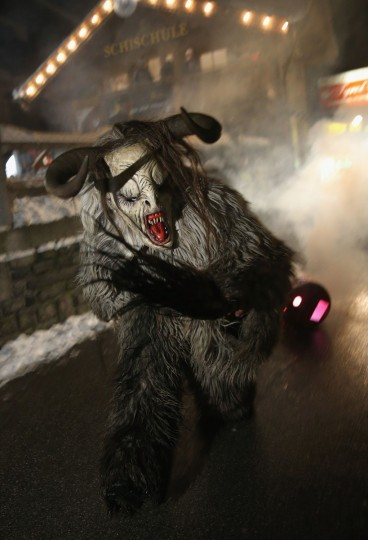 A participant dressed as the Krampus creature pulls a barrel of fire during his search for delinquent children during Krampus night on November 30, 2013 in Neustift im Stubaital, Austria. Sixteen Krampus groups including over 200 Krampuses participated in the first annual Neustift event. Krampus, in Tyrol also called Tuifl, is a demon-like creature represented by a fearsome, hand-carved wooden mask with animal horns, a suit made from sheep or goat skin and large cow bells attached to the waist that the wearer rings by running or shaking his hips up and down. Krampus has been a part of Central European, alpine folklore going back at least a millennium, and since the 17th-century Krampus traditionally accompanies St. Nicholas and angels on the evening of December 5 to visit households to reward children that have been good while reprimanding those who have not. However, in the last few decades Tyrol in particular has seen the founding of numerous village Krampus associations with up to 100 members each and who parade without St. Nicholas at Krampus events throughout November and early December. (Sean Gallup/Getty Images)