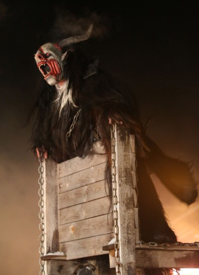 A participant dressed as the Krampus creature howls from his Krampus wagon during his search for delinquent children on Krampus night on November 30, 2013 in Neustift im Stubaital, Austria. Sixteen Krampus groups including over 200 Krampuses participated in the first annual Neustift event. Krampus, in Tyrol also called Tuifl, is a demon-like creature represented by a fearsome, hand-carved wooden mask with animal horns, a suit made from sheep or goat skin and large cow bells attached to the waist that the wearer rings by running or shaking his hips up and down. Krampus has been a part of Central European, alpine folklore going back at least a millennium, and since the 17th-century Krampus traditionally accompanies St. Nicholas and angels on the evening of December 5 to visit households to reward children that have been good while reprimanding those who have not. However, in the last few decades Tyrol in particular has seen the founding of numerous village Krampus associations with up to 100 members each and who parade without St. Nicholas at Krampus events throughout November and early December. (Sean Gallup/Getty Images)