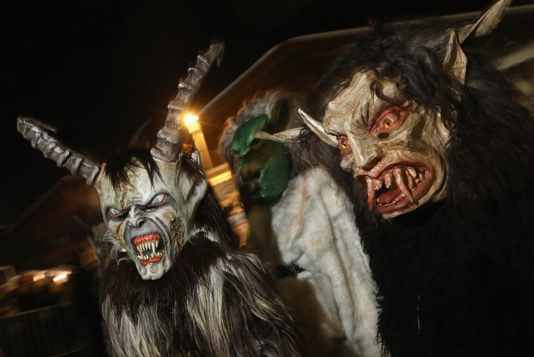Young children dressed as the Krampus creature walk the streets during Krampus night on November 30, 2013 in Neustift im Stubaital, Austria. Sixteen Krampus groups including over 200 Krampuses participated in the first annual Neustift event. Krampus, in Tyrol also called Tuifl, is a demon-like creature represented by a fearsome, hand-carved wooden mask with animal horns, a suit made from sheep or goat skin and large cow bells attached to the waist that the wearer rings by running or shaking his hips up and down. Krampus has been a part of Central European, alpine folklore going back at least a millennium, and since the 17th-century Krampus traditionally accompanies St. Nicholas and angels on the evening of December 5 to visit households to reward children that have been good while reprimanding those who have not. However, in the last few decades Tyrol in particular has seen the founding of numerous village Krampus associations with up to 100 members each and who parade without St. Nicholas at Krampus events throughout November and early December. (Sean Gallup/Getty Images)