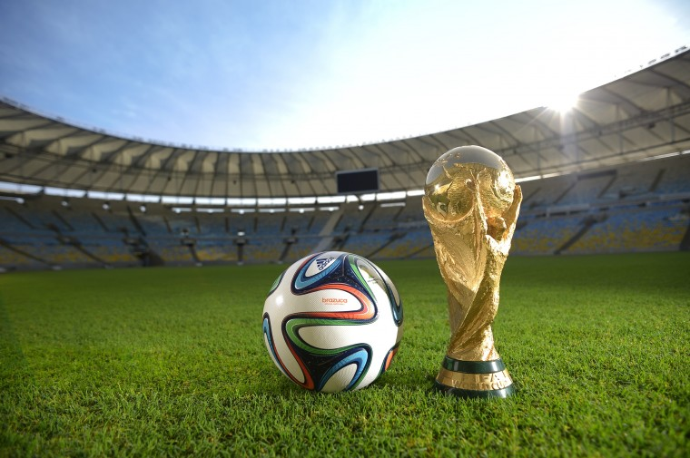 Brazuca and the FIFA World Cup Trophy at the Maracana are pictured before the adidas Brazuca launch at Parque Lage in Rio de Janeiro, Brazil. (Photo by Alexandre Loureiro/Getty Images for adidas)
