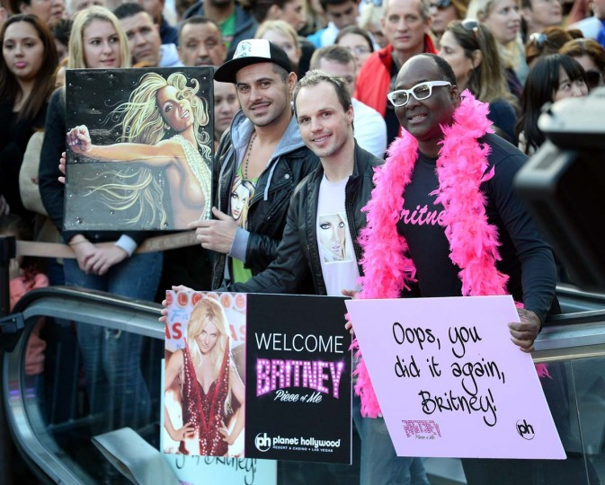 "LAS VEGAS, NV - DECEMBER 03: Fans hold signs as they wait for Britney Spears to arrive at a welcome ceremony as she celebrates the release of her new album ""Britney Jean"" and prepares for her two-year residency at Planet Hollywood Resort & Casino in Las Vegas. Spears' show ""Britney: Piece of Me"" will debut at the resort on December 27. (Photo by Ethan Miller/Getty Images)"