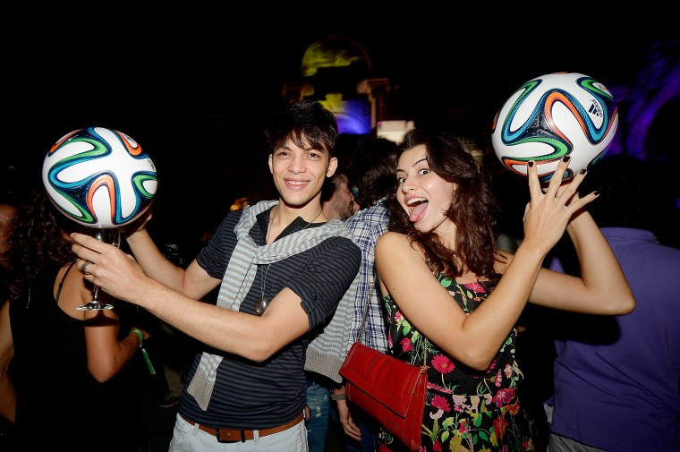 Guests pose with the Brazuca ball during the adidas Brazuca launch at Parque Lage in Rio. (Photo by Alexandre Loureiro/Getty Images for adidas)
