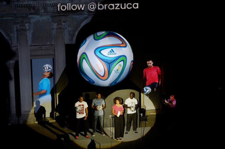 Cafu, Hernane, Sheron Menezzes and Seedorf pose with the World Cup Brazuca ball during the adidas Brazuca launch at Parque Lage in Rio de Janeiro, Brazil. (Photo by Alexandre Loureiro/Getty Images for adidas)