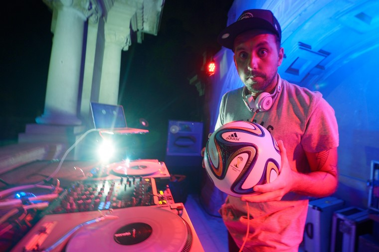 DJ Zeh Pretim poses with the Brazuca ball during the adidas Brazuca launch at Parque Lage in Rio de Janeiro, Brazil. (Photo by Alexandre Loureiro/Getty Images for adidas)
