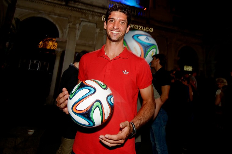 Brazilian tennis player Thomaz Bellucci poses with the Brazuca ball during the adidas Brazuca launch at Parque Lage in Rio de Janeiro, Brazil. (Photo by Alexandre Loureiro/Getty Images for adidas)