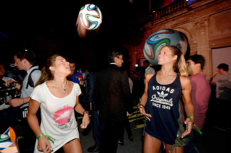Brazilian synchronized swimming athletes Bianca Feres and Branca Feres pose with the Brazuca ball during the adidas Brazuca launch at Parque Lage in Rio de Janeiro, Brazil. (Photo by Alexandre Loureiro/Getty Images for adidas)