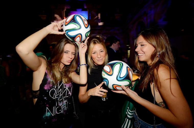 Guests pose with the Brazuca ball during the adidas Brazuca launch at Parque Lage in Rio de Janeiro, Brazil. (Photo by Alexandre Loureiro/Getty Images for adidas)