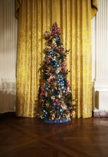 A Christmas tree stands in the East Room of the White House December 4, 2013 in Washington, DC. U.S. first lady Michelle Obama will host today military families for the first viewing of the 2013 holiday decorations and demonstrating holiday crafts and treats to military children. (Alex Wong/Getty Images)