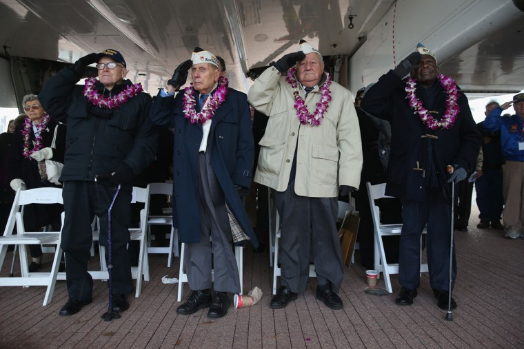 Pearl Harbor survivors salute during the U.S. national anthem at a ceremony marking the 72nd anniversary of the attack on Pearl Harbor, Hawaii on December 7, 2013 in New York City. Four Pearl Harbor survivors from the New York area gathered with former crew members of the USS Intrepid to mark the Japanese surprise attack on December 7, 1941 which killed 2,402 Americans and brought the United States into WWII. (John Moore/Getty Images)