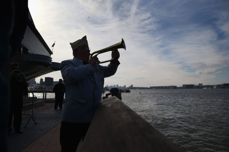 A bugler plays Taps at a ceremony marking the 72nd anniversary of the attack on Pearl Harbor, Hawaii on December 7, 2013 in New York City. Four Pearl Harbor survivors from the New York area gathered with former crew members of the USS Intrepid to mark the Japanese surprise attack on December 7, 1941 which killed 2,402 Americans and brought the United States into WWII. (John Moore/Getty Images)