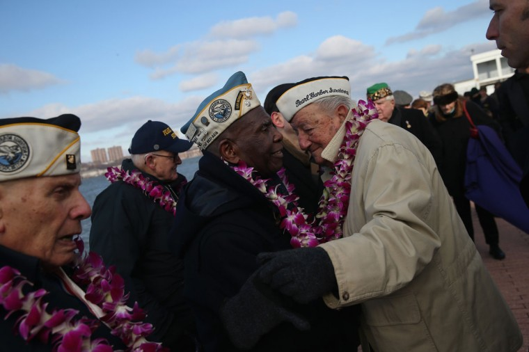 Pearl Harbor survivors embrace at a ceremony marking the 72nd anniversary of the attack on Pearl Harbor, Hawaii on December 7, 2013 in New York City. Four Pearl Harbor survivors from the New York area gathered with former crew members of the USS Intrepid to mark the Japanese surprise attack on December 7, 1941 which killed 2,402 Americans and brought the United States into WWII. (John Moore/Getty Images)