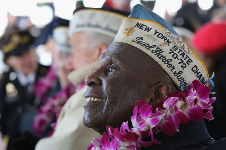 Pearl Harbor survivor Clark Simmons, 92, takes part in a ceremony marking the 72nd anniversary of the attack on December 7, 2013 in New York City. Four Pearl Harbor survivors from the New York area gathered with former crew members of the USS Intrepid to mark the Japanese surprise attack on December 7, 1941 which killed 2,402 Americans and brought the United States into WWII. (John Moore/Getty Images)