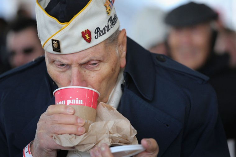 Pearl Harbor survivor Aaron Chavin, 90, warms up with a cup of coffee at a ceremony marking the 72nd anniversary of the attack on Pearl Harbor, Hawaii on December 7, 2013 in New York City. Four Pearl Harbor survivors from the New York area gathered with former crew members of the USS Intrepid to mark the Japanese surprise attack on December 7, 1941 which killed 2,402 Americans and brought the United States into WWII. (John Moore/Getty Images)