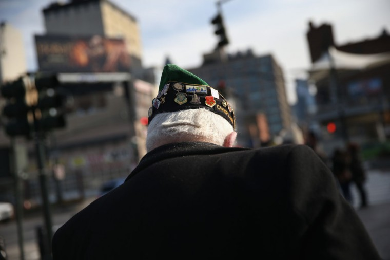 A veteran leaves a ceremony marking the 72nd anniversary of the attack on Pearl Harbor, Hawaii on December 7, 2013 in New York City. Four Pearl Harbor survivors from the New York area gathered with former crew members of the USS Intrepid to mark the Japanese surprise attack on December 7, 1941 which killed 2,402 Americans and brought the United States into WWII. (John Moore/Getty Images)