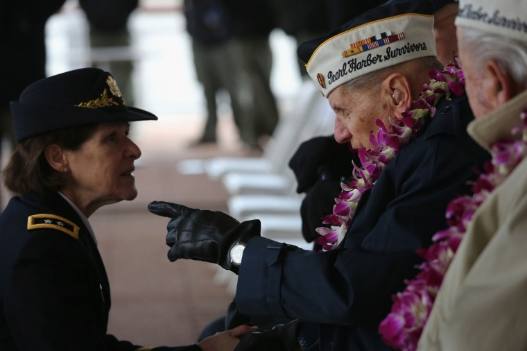 Pearl Harbor survivor Aaron Chavin, 90, speaks with U.S. Army Major General Margaret Boor at a ceremony marking the 72nd anniversary of the attack on Pearl Harbor, Hawaii on December 7, 2013 in New York City. Four Pearl Harbor survivors from the New York area gathered with former crew members of the USS Intrepid to mark the Japanese surprise attack on December 7, 1941 which killed 2,402 Americans and brought the United States into WWII. (John Moore/Getty Images)