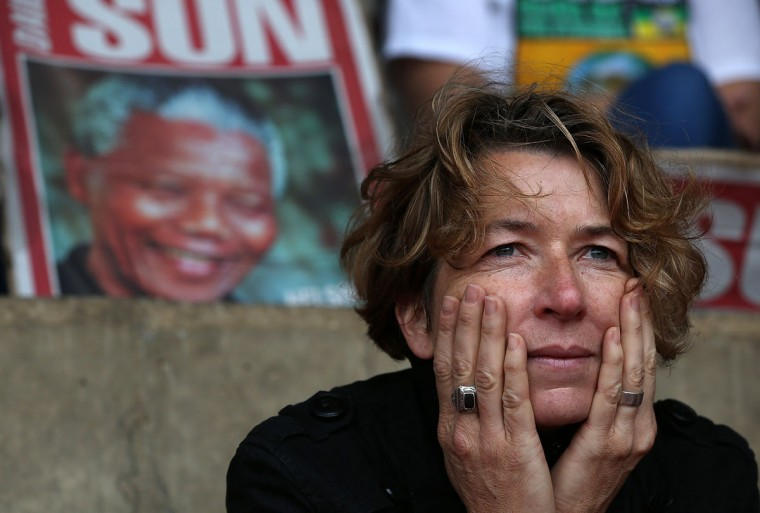 A spectator watches a telecast of the Nelson Mandela memorial service at Ellis Park on December 10, 2013 in Johannesburg, South Africa. Over 60 heads of state have traveled to South Africa to attend a week of events commemorating the life of former South African President Nelson Mandela. (Justin Sullivan/Getty Images)