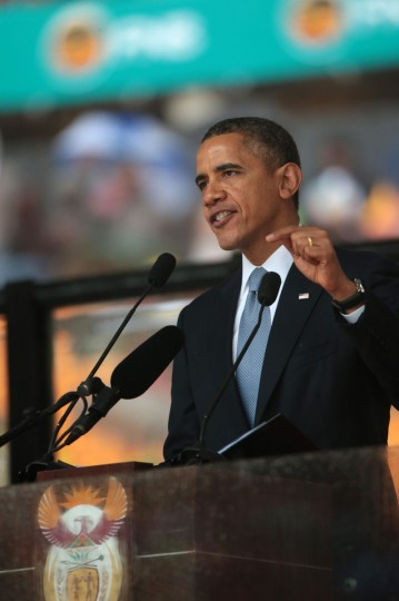 United States President Barack Obama speaks during the official memorial service for former South African President Nelson Mandela at the FNB Stadium on December 10, 2013 in Johannesburg, South Africa. Over 60 heads of state have traveled to South Africa to attend a week of events commemorating the life of former South African President Nelson Mandela, who passed away on the evening of Dec. 5, 2013 at his home. Mandela became South Africa's first black president in 1994 after spending 27 years in jail for his activism against apartheid in a racially-divided South Africa. (Christopher Furlong/Getty Images)