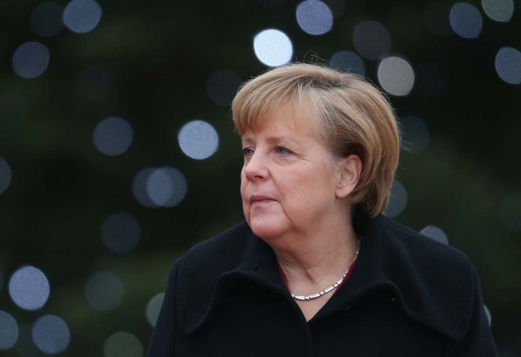 German Chancellor Angela Merkel awaits President Ibrahim Boubacar Keita of Mali (not pictured) in front of a Christmas tree upon Keita's arrival at the Chancellery on December 11, 2013 in Berlin, Germany. Merkel will likely be confirmed for another term as chancellor next week following the vote count of members of the German Social Democrats (SPD) over the future government coalition on the weekend. (Photo by Sean Gallup/Getty Images)