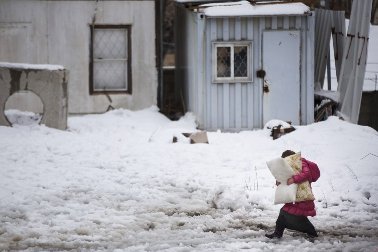 An Ultra orthodox Jewish girl carries pillows as she walks in the snow a head of Shabat (Saturday), in the Mea Shearim Ultra Orthodox Jewish neighborhood on December 13, 2013 in Jerusalem, Israel. Heavy storms continued throughout Israel on Friday, causing traffic disruptions and power outages across the country. (Uriel Sinai/Getty Images)