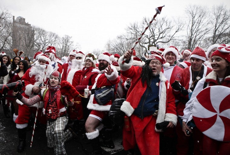 Revelers dressed as Santa Claus pose for a picture at Tompkins Square Park to take part during the annual SantaCon bar crawl event on December 14, 2013 in New York City. The SantaCon annual event occurs worldwide in more than 300 cities in 44 countries. In New York some community groups have established a 'Santa Free' zone that urges bars not to serve alcoholic beverages to people participating in order to dissuade incidents of public vomiting and urination in the streets. (Kena Betancur/Getty Images)