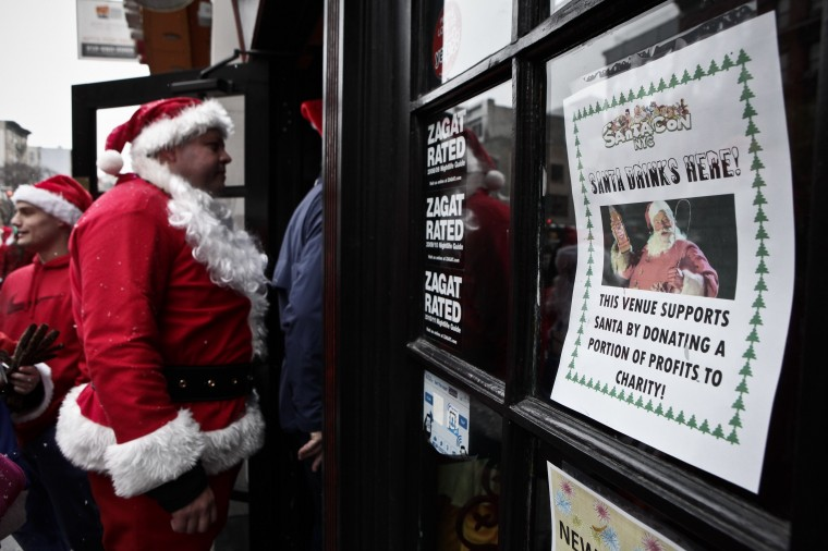 Revelers Dressed As Santa Take Part In Annual Bar Crawl Thru NYC