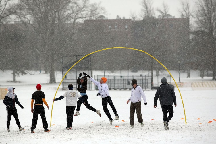 A group of men play the frisbee game of Goaltimate in Prospect Park during a snow storm on December 14, 2013 in Brooklyn. (Spencer Platt / Getty Images)