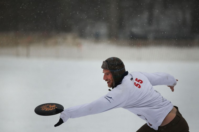 A man goes for a catch of a frisbee during a game of Goaltimate in Prospect Park during a snow storm on December 14, 2013 in Brooklyn. (Spencer Platt / Getty Images)
