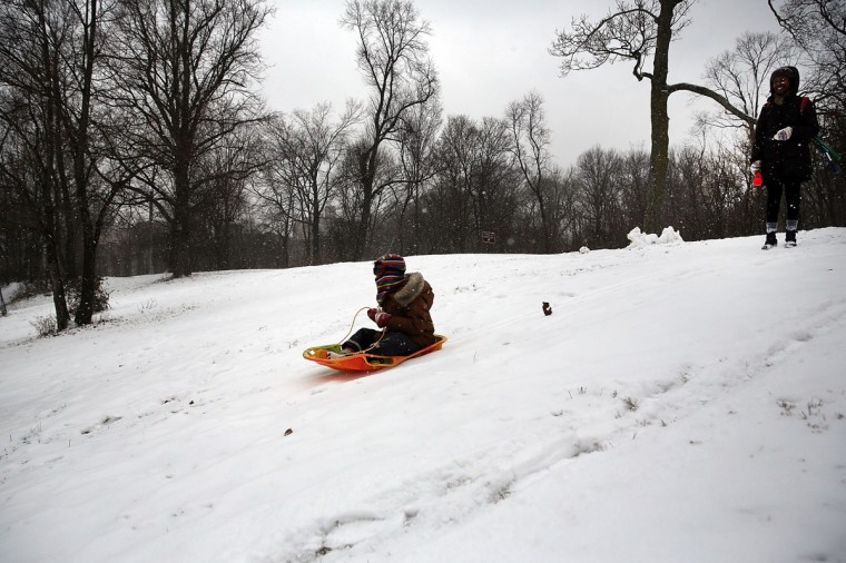 A child sleds in Prospect Park during a snow storm on December 14, 2013 in Brooklyn. (Spencer Platt/Getty Images)