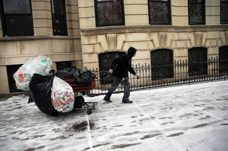 A man collects cans during a snow storm on December 14, 2013 in the Brooklyn borough of New York City. (Spencer Platt/Getty Images)