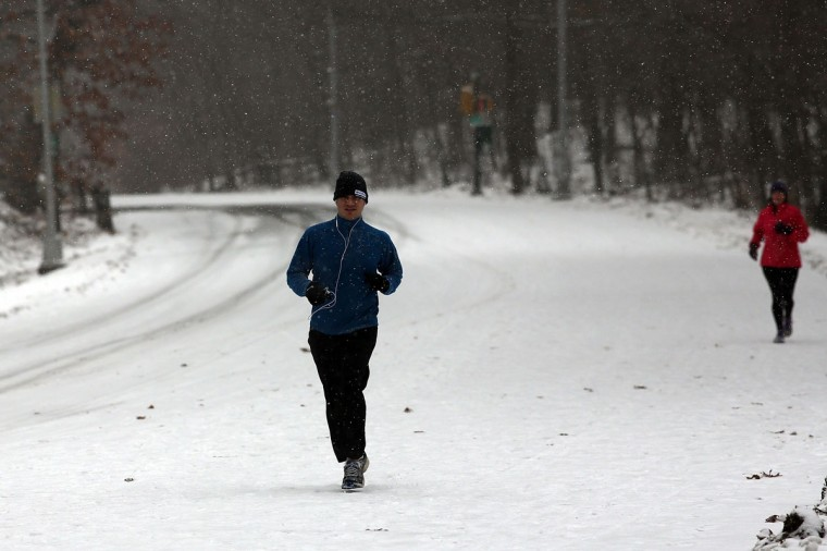 People run through Prospect Park during a snow storm on December 14, 2013 in the Brooklyn borough of New York City. (Spencer Platt/Getty Images)