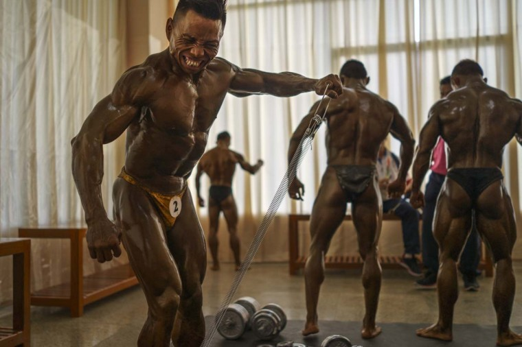 Tun Min of Myanmar works out amongst other athletes before competing in the 55kg bodybuilding contest at the Myanmar Convention Center during the 2013 SEA Game on December 14, 2013 in Yangon, Burma. (Ruben Salgado Escudero/Getty Images)