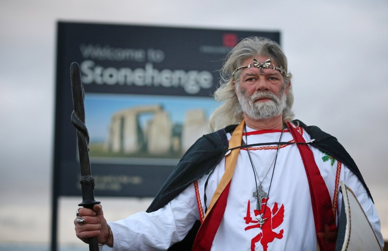 King Arthur Pendragon, a senior Druid, poses for a photograph as he begins a protest march from the old Stonehenge visitor centre to the recently opened new one in protest at English Heritage display of ancient human remains excavated from the environs of Stonehenge on December 18, 2013 in Wiltshire, England. English Heritage unveiled the new multi-million pound visitor centre at Stonehenge - located about a mile-and-a-half (2km) from the stones - which also included grassing over the road alongside the ancient monument and closure of the existing 1960s facilities this week. Stonehenge, built between 3,000 BC and 1,600 BC, attracts around 900,000 visitors a year, with 70 percent of those from overseas. (Matt Cardy/Getty Images)
