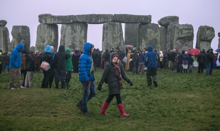 Rain falls as druids, pagans and revellers gather at Stonehenge, hoping to see the sun rise, as they take part in a winter solstice ceremony at Stonehenge on December 21, 2013 in Wiltshire, England. Despite the rain and wind, a large crowd gathered at the famous historic stone circle to celebrate the sunrise closest to the Winter Solstice, the shortest day of the year - an event claimed to be more important in the pagan calendar than the summer solstice, because it marks the 're-birth' of the Sun for the New Year.
