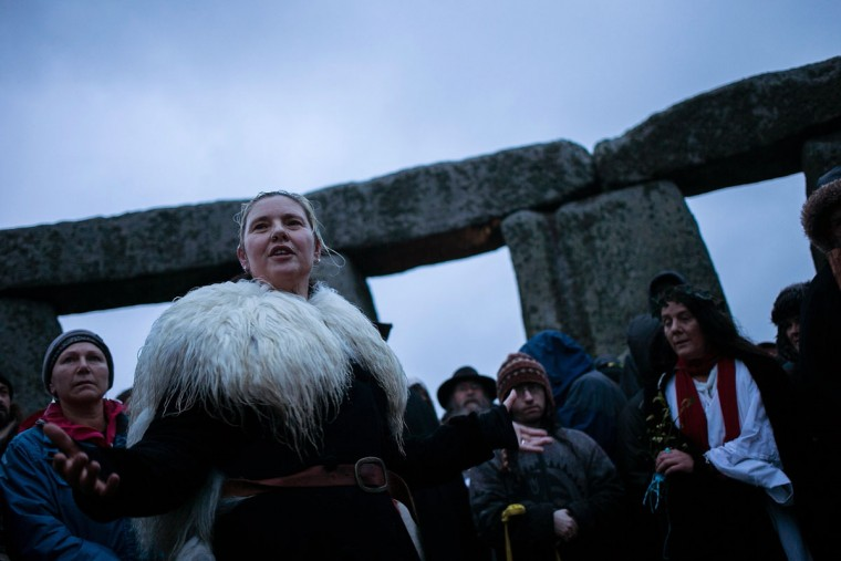 Druids, pagans and revellers gather in the centre of Stonehenge, hoping to see the sun rise, as they take part in a winter solstice ceremony at Stonehenge on December 21, 2013 in Wiltshire, England. Despite the rain and wind, a large crowd gathered at the famous historic stone circle to celebrate the sunrise closest to the Winter Solstice, the shortest day of the year - an event claimed to be more important in the pagan calendar than the summer solstice, because it marks the 're-birth' of the Sun for the New Year.