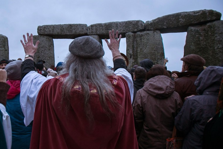 Rollo Maughfling, Archdruid of Stonehenge & Britain, turns to the stones as he conducts a ceremony as druids, pagans and revellers gather, hoping to see the sun rise as they take part in a winter solstice ceremony at Stonehenge on December 21, 2013 in Wiltshire, England. Despite the rain and wind, a large crowd gathered at the famous historic stone circle to celebrate the sunrise closest to the Winter Solstice, the shortest day of the year - an event claimed to be more important in the pagan calendar than the summer solstice, because it marks the 're-birth' of the Sun for the New Year.
