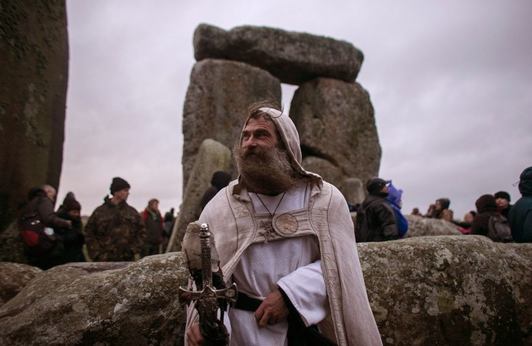 Druid Merlin poses for a photograph as druids, pagans and revellers gather, hoping to see the sun rise as they take part in a winter solstice ceremony at Stonehenge on December 21, 2013 in Wiltshire, England. Despite the rain and wind, a large crowd gathered at the famous historic stone circle to celebrate the sunrise closest to the Winter Solstice, the shortest day of the year - an event claimed to be more important in the pagan calendar than the summer solstice, because it marks the 're-birth' of the Sun for the New Year.