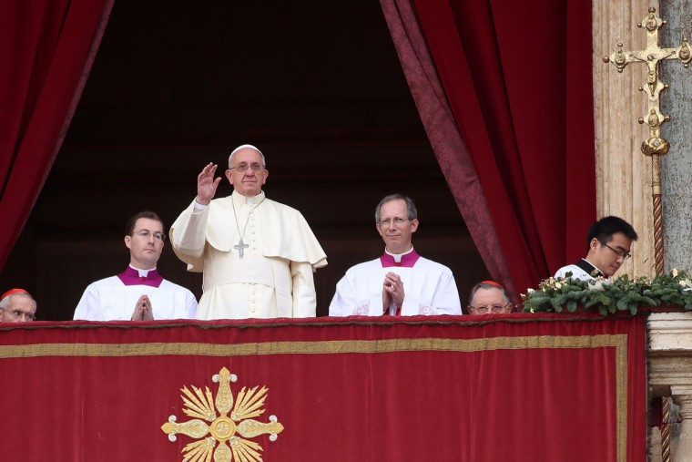 Pope Francis waves before delivering his Christmas Day message from the central balcony of St. Peter's Basilica on December 25, 2013 in Vatican City, Vatican. (Franco Origlia/Getty Images)