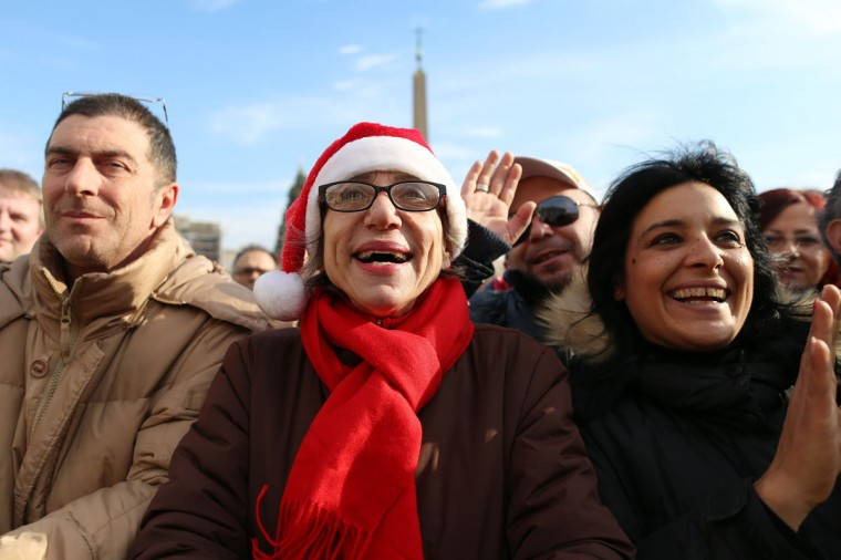 People in St. Peter's Square attend Pope Francis' Christmas Day message from the central balcony of St Peter's Basilica on December 25, 2013 in Vatican City, Vatican. (Franco Origlia/Getty Images)