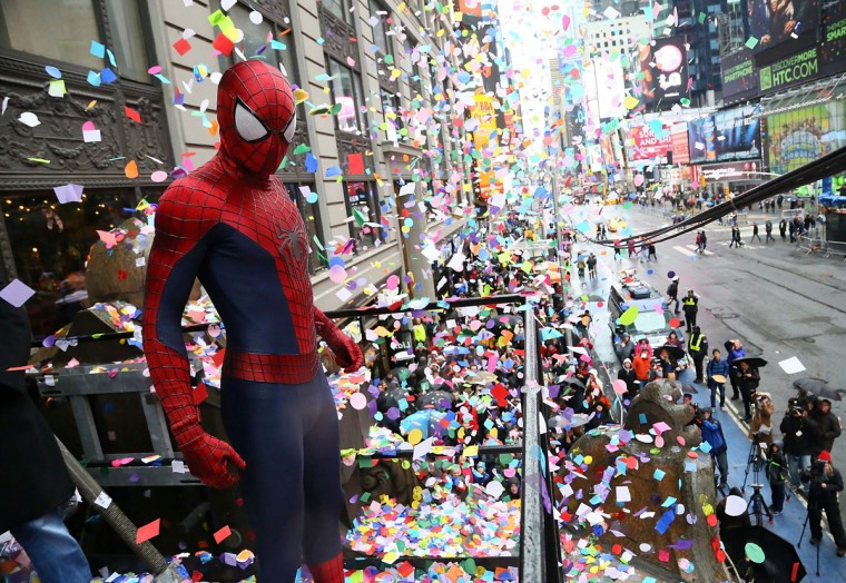 A person dressed as Spider-Man throws confetti during the 2014 New Year's Eve Confetti Test at Hard Rock Cafe, Times Square on December 29, 2013 in New York City. (Astrid Stawiarz/Getty Images)
