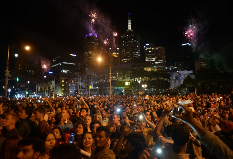 New Years revelers watching the fireworks on the Princes Bridge during New Years Eve fireworks on December 31, 2013 in Melbourne, Australia. (Vince Caligiuri/Getty Images)