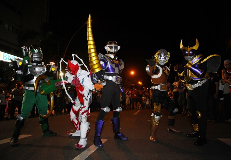 Indonesian Cosplay Community perform on the street to celebrate 2014 New Years on December 31, 2013 in Surabaya, Indonesia. A wave of pyrotechnic displays kicked off New Years celebrations in major cities around the world. (Robertus Pudyanto/Getty Images)