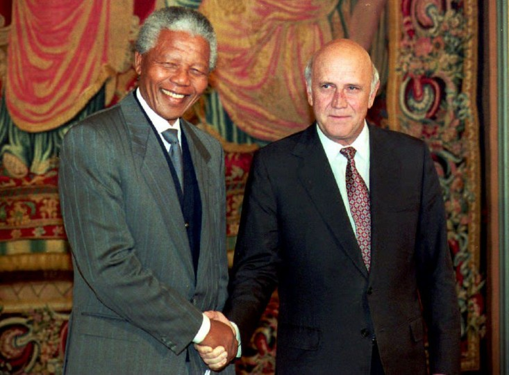 Nelson Mandela (L) ANC president and South African President Frederik de Klerk shake hands at the Grand Hotel in Oslo 09 December 1993, on the eve before receiving jointly the Nobel Peace prize. (Gerard Julien/AFP/Getty Images)