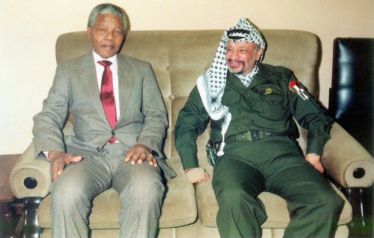 In this undated file photo Palestinian leader Yasser Arafat is pictured meeting with Nelson Mandela the former leader of South Africa. Medics announced on October 31, 2004 that Arafat's health is in a serious condition, after the illness that has persisted for two weeks, took a sudden turn for the worse. Test have so far proved inconclusive and more results are expected on Wednesday. (Palestinian Authorities via Getty Images)