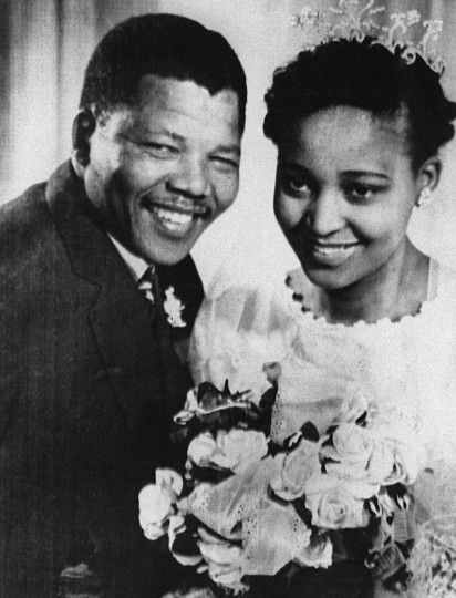 A file photo taken in 1957 shows South African anti-apartheid leader and African National Congress (ANC) member Nelson Mandela posing with his wife Winnie during their wedding. (Getty Images)