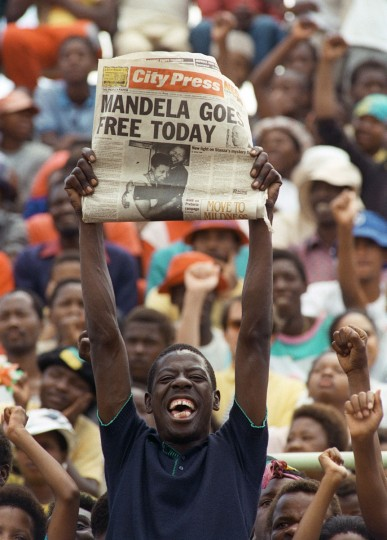 A file photo taken on February 11, 1990 shows a jubilant Sowetan holding up a newspaper announcing the release of anti-apartheid leader and African National Congress (ANC) member Nelson Mandela, at a mass ANC rally in Soweto. South African President de Klerk lifted on February 2, the 30-year-old ban on the ANC and the South African Communist Party, leading to the release on February 11 of Nelson Mandela from the Victor Vester prison, near Cape Town, after a 27-year imprisonnement. (Trevor Samson/AFP/Getty Images)