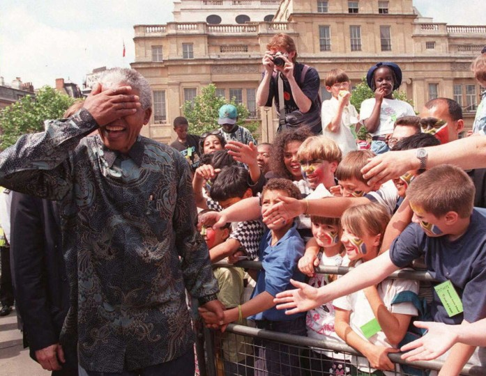 South African President Nelson Mandela goes on a walkabout round Trafalgar Square in London 12 July 1996 on his way to South Africa House, where he made a speech from the balcony to the crowds. Mandela was on the last day of his four-day state visit to the United Kingdom. (Getty Images)