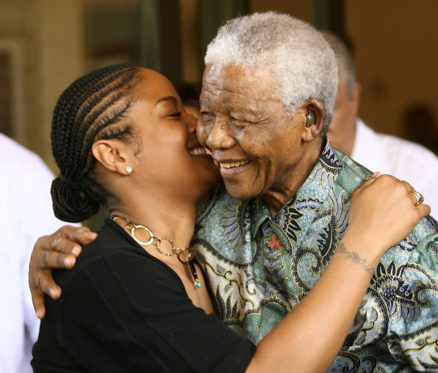 Laila Ali (L), the daughter of boxing legend Muhammad Ali, gives a hug to former South African president and Nobel Peace prize laureate Nelson Mandela (R) during a visit at the Nelson Mandela Foundation in Johannesburg on 30 January 2007. Ali is in South Africa to defend her light heavyweight world title against Gwendolyn O'Neill 03 February 2007, the first ever boxing tournament to be head by a female in South Africa. (Getty Images)