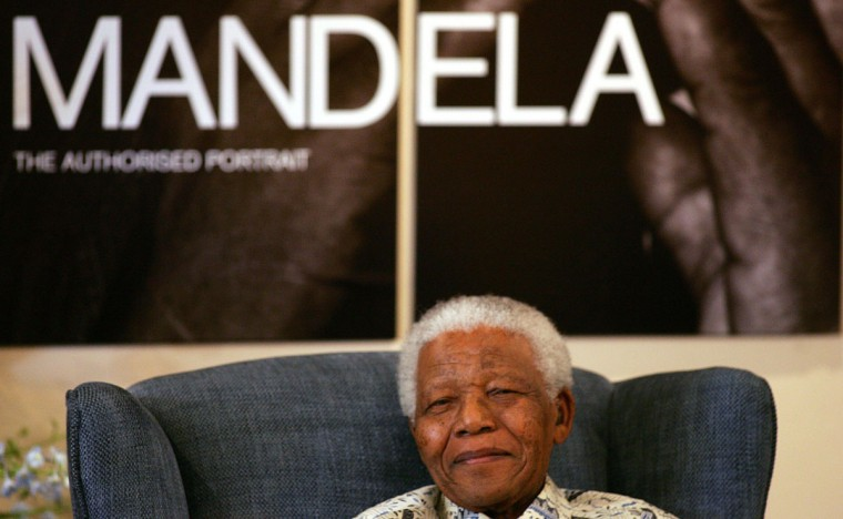 South Africa's former President Nelson Mandela poses at the launch of the new book Mandela: The Authorised Portrait on October 9, 2006 in Johannesburg. (Alexander Joel/AFP/Getty Images)